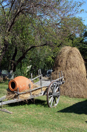 ethnographical: Rural landscape: traditional georgian wine jug and hay