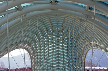 Details of famouse Peace bridge in Tbilisi, Georgia             Stock Photo