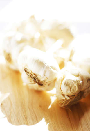 Closeup of garlic heads on the wooden desk Stock Photo - 15984853