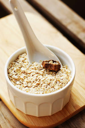 close up of wheat flakes in wooden spoon photo