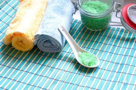 wrest: bath accessories: sea salt and towels Stock Photo