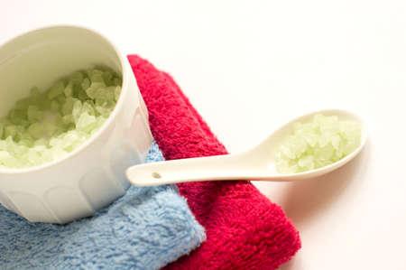 wrest: bath accessories: sea salt and towels Stock Photo