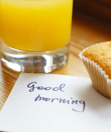 Healthy breakfast: fresh orange juice and cupcake