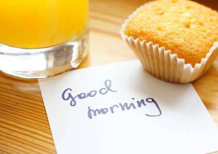 good health: Healthy breakfast: fresh orange juice and cupcake