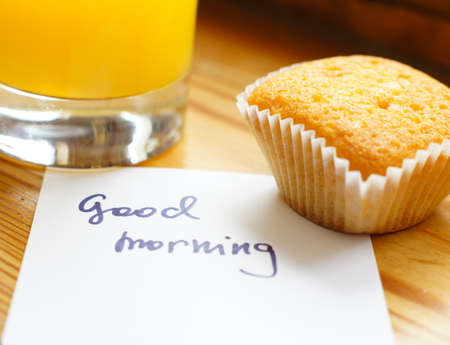 Healthy breakfast: fresh orange juice and cupcake
