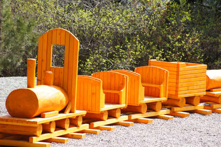 Children playground: wooden painted train photo