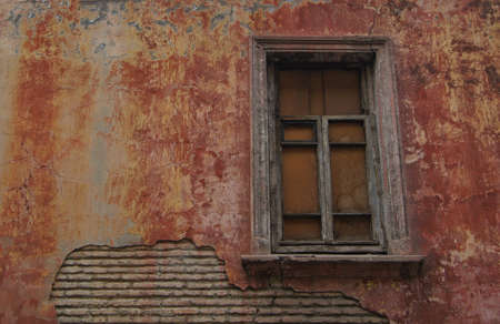 Old red wall with window photo