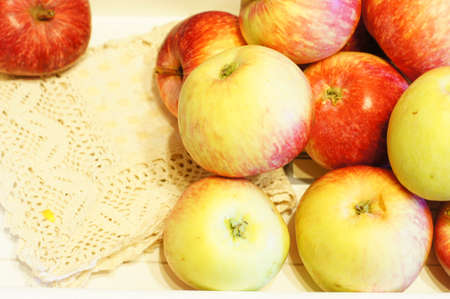 Fresh apple fruits on the wooden desk photo