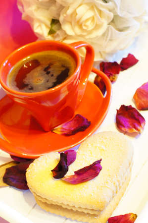 Cup of coffee and heart shape cookies photo