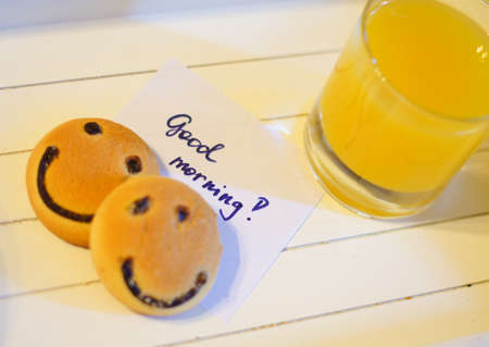 Healthy breakfast: fresh orange juice and smile cake