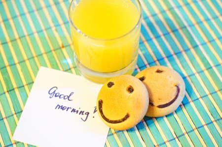 good morning: Healthy breakfast: fresh orange juice and smile cake