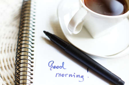 Morning time: cup of coffee and Good morning greeting card Stock Photo