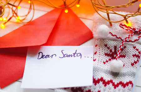 envelope: Christmas letter to Santa Claus and different holiday decoration Stock Photo