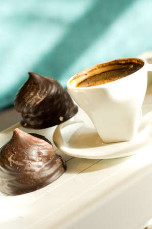 cup of hot coffee  decorated with heart-shaped cookies on the table photo