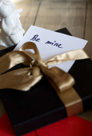 St. Valentine day's present with a note 'Be mine' photo