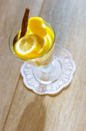 non alcoholic beverage: Glass with cut lemon fruit and water Stock Photo