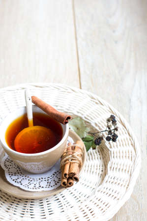 stimulated: Cup of tea with lemon on the wooden table