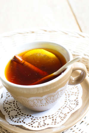 Cup of tea with lemon on the wooden table photo