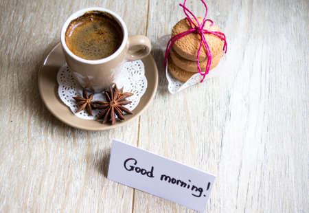 Cup of black coffee and Good morning note