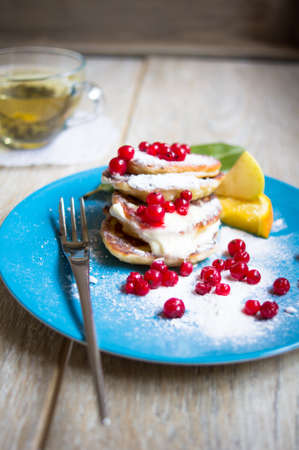 maslenitsa: Healthy food, pakcakes with fresh fruits, honey and sour cream, green tea Stock Photo