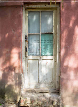 ethnographical: Wooden door in old house in the wood