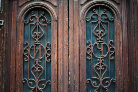 rehabilitated people: Art-Nouveau door with forged iron in Tbilisi Old town, unrestored area Stock Photo