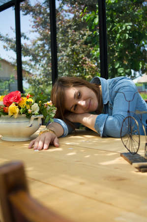 Beautiful young woman at old-styled home photo
