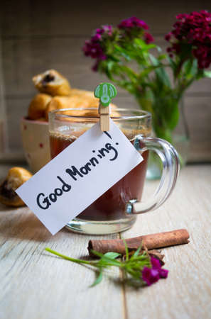 good morning: Croisant with chocolate, flowers and coffee with good morning note Stock Photo