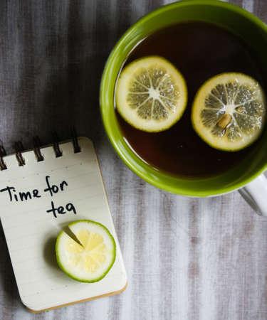 convalesce: Mug with tea and lemon, and note