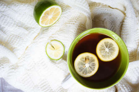 Cold time, tea with lemon and warm scarf photo