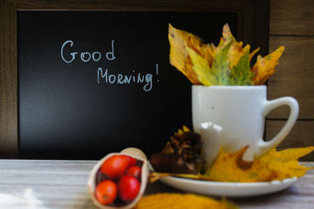 good morning: Hot hip tea with berries and Good morning note on a chalkboard