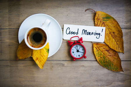 climate morning: Autumn time, cup of coffee, yellow autumnal leaves and notes