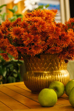 Autumn flowers in the vase on the table photo