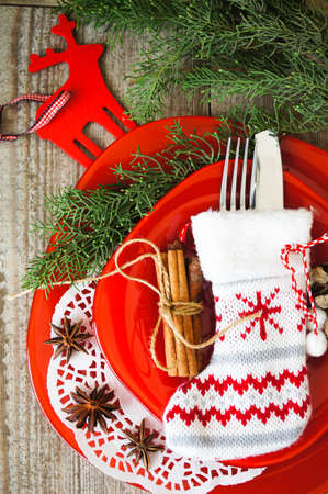 Table decoration for Christmas eve with bright table set Imagens