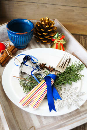 Table decoration for Christmas eve with bright table set photo