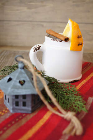 Mug of tea and orange on the table photo