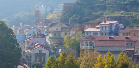 View to old town of Tbilisi city in autumnal colors photo