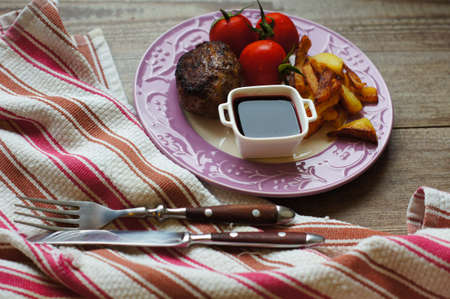 Plate with fried potatoes, vegetables and meat for dinner photo