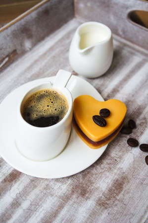 mocca: Heart shaped Mocca cake with cup of coffee and Valentine deocrations
