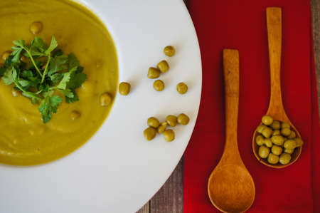 green pea: Fresh green pea soup with pea seeds and pea pods around. Selective Focus
