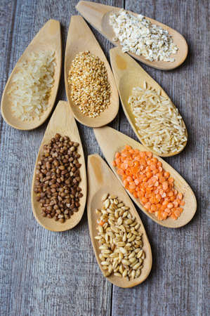 various food ingredients : beans, legumes, peas, lentils in wooden spoon and glass bowls photo