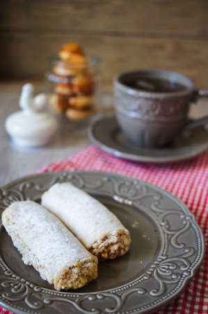 Cup of tea and cookies on the wooden table photo