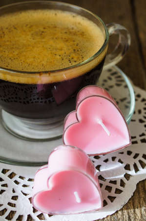Cup of coffee with red cloves flowers for Valentines day photo