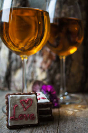 champagne truffles chocolate: Glasses of white wine and cookies for Valentines Day