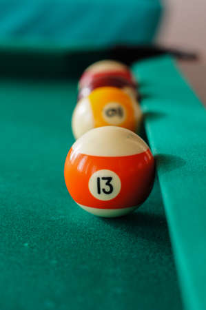 billiards hall: Billiard balls on a pool table. selective focus