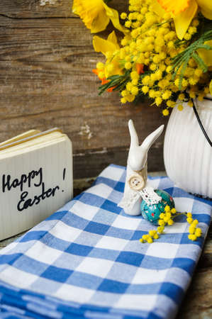 Easter time, spring flowers, easter eggs and  easter bunny photo