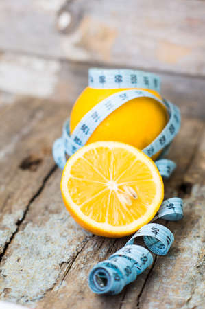 citric: Healthy food, lemon smoothie with lemon fruits on the wooden background