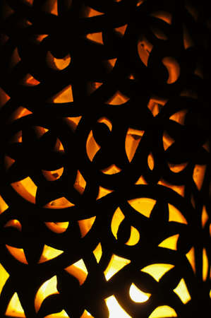 Arabian lamp with beautiful shadows on wall. Concept for Moroccan and Arabian culture and design.