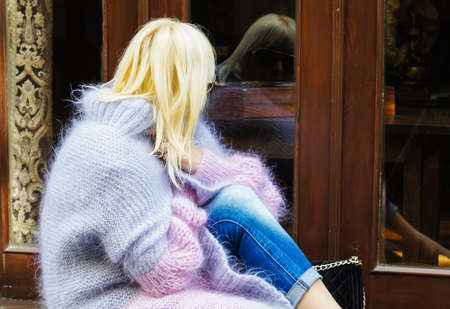 knitted jacket: Beautiful blond woman in knitted jacket outdoor