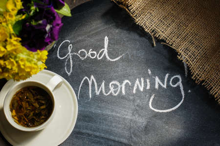 good morning: Cup o tea and spring flowers with good morning note